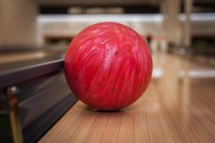The bowling ball is ready to strike. In sport center stock images