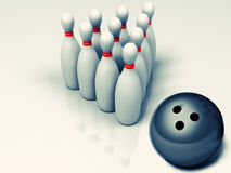Bowling ball rolling towards pins Stock Image