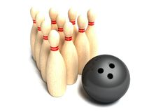 Bowling ball rolling towards pins Royalty Free Stock Photos