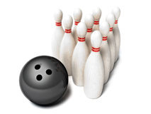 Bowling ball rolling towards pins Stock Photo