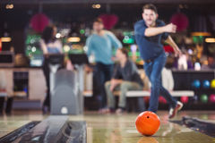 Bowling ball is rolling towards the pins Royalty Free Stock Photo