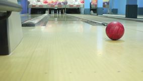 Bowling ball rolls on the floor stock video