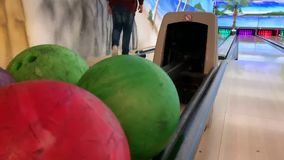 Bowling ball rolls out for other players