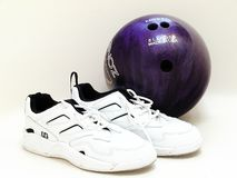 Bowling Ball and Shoes. White ladies bowling shoes and purple ball Royalty Free Stock Photography