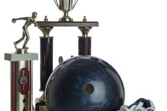 Bowling ball, shoes and tropies Royalty Free Stock Image