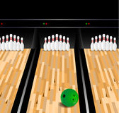 Bowling ball and skittle on wooden floor. Bowling scene Royalty Free Stock Images