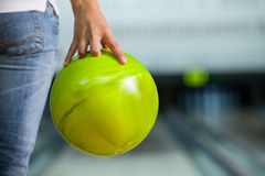 Bowling ball. Woman hand holding his bowling ball Stock Images
