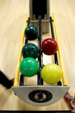 Bowling balls at alley. Bowling balls in the rack at a bowling alley stock photo
