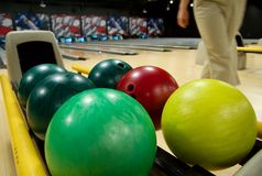Bowling balls at alley. Bowling balls in the rack at a bowling alley stock photos