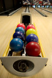 Bowling balls at alley. Bowling balls in the rack at a bowling alley royalty free stock image