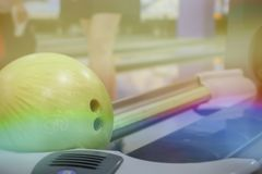 Bowling balls on blurred background. Bowling ball on the background of the silhouette of the girl, blurred background Royalty Free Stock Image