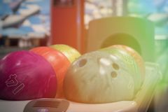 Bowling balls on blurred background. A rack with various bowling balls, blurred background Royalty Free Stock Images