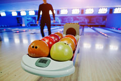 Bowling balls at bowl lift with ultraviolet lighting Stock Images