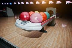 Bowling balls at bowl lift with ultraviolet lighting Stock Image
