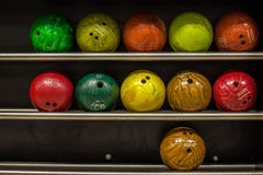 Bowling balls. Multi colored bowling balls on a rack stock images