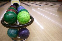 Bowling balls perspective in game center Royalty Free Stock Photos