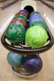Bowling balls perspective in game center Stock Photo