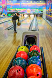Bowling balls and player on blurred background Stock Images
