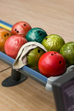 Bowling balls in the rack. Balls for bowling on a shelf Stock Images