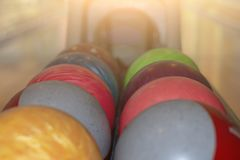 Bowling balls on the rack. Selective focus. royalty free stock photos