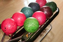 Bowling balls red green closeup row Stock Photo