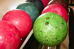 Bowling balls red green closeup row Royalty Free Stock Photo
