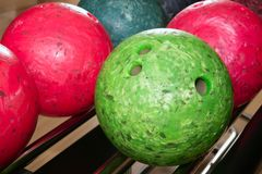 Bowling balls red green closeup row Stock Photos