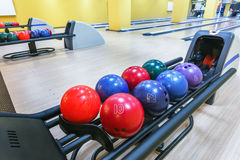 Bowling balls return machine, alley background. Bowling background. Interior of bowling alley lane with balls return machine closeup Royalty Free Stock Images
