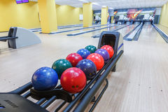 Bowling balls return machine, alley background. Bowling background. Interior of bowling alley lane with balls return machine closeup Royalty Free Stock Photography
