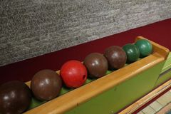 Bowling balls in a row on an ancient skittles alley stock photography