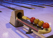 Bowling balls in a row Stock Photography