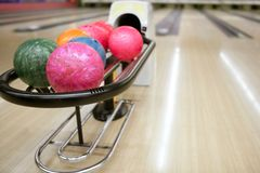 Bowling balls and wooden floor perspective Royalty Free Stock Image