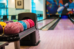 Bowling balls. And wooden lane in bowling hall Royalty Free Stock Photo