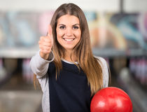 Bowling. Beautiful young woman in a bowling alley is having fun stock photos