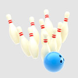 Bowling blue ball smashing to pins isolated Royalty Free Stock Photo