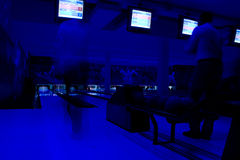 Bowling Blues. People bowling with UV neon lights turned on Royalty Free Stock Photo