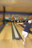 Bowling Blur. Step up and roll the ball, fast zoom in and out to give this image some bowling action Stock Photos