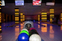 Bowling. Colored balls in the bowling alley stock photography
