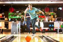Bowling is fun. Bowling with a couple of friends in a bowling alley is good fun, and a great idea for a night out stock photo