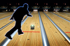 Bowling game. Silhouette of a bowling player throwing the ball in the alley Stock Photos