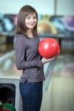 Bowling Game. Young beautiful smiling girl playing bowling Royalty Free Stock Photo