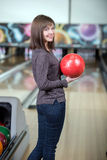 Bowling Game. Young beautiful smiling girl playing bowling Royalty Free Stock Photography
