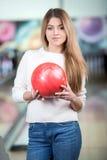 Bowling Game. Young beautiful smiling girl playing bowling Stock Photography