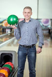 Bowling Game. Cheerful young man playing bowling Stock Image