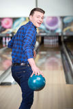 Bowling Game. Cheerful young man playing bowling Stock Images