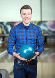 Bowling Game. Cheerful young man playing bowling Stock Photography