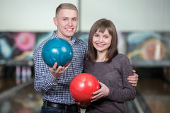 Bowling Game. Cheerful young couple playing bowling Stock Photography