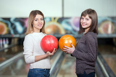Bowling Game. Young beautiful smiling girl playing bowling Stock Images