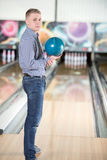 Bowling Game. Cheerful young man playing bowling Stock Photos