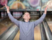 Bowling Game. Cheerful young man playing bowling Stock Photo